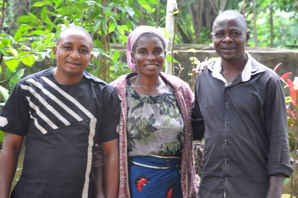 L-R Augustine Adah, his mother and his brother, Emmanuel